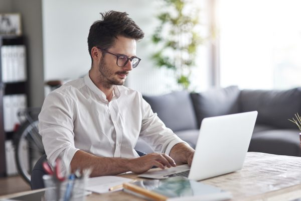 Businessman working on laptop at home office
